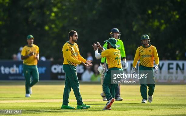 Belfast , United Kingdom - 22 July 2021; Temba Bavuma, right, is congratulated by team-mate Tabraiz Shamsi after catching out Shane Getkate of...