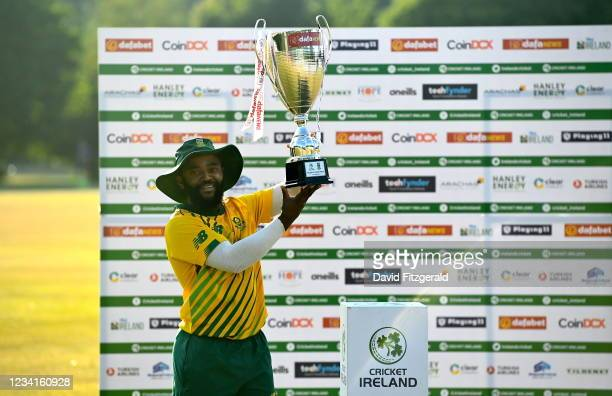 Belfast , United Kingdom - 24 July 2021; South Africa captain Temba Bavuma lifts the cup after they won the Men's T20 International series between...
