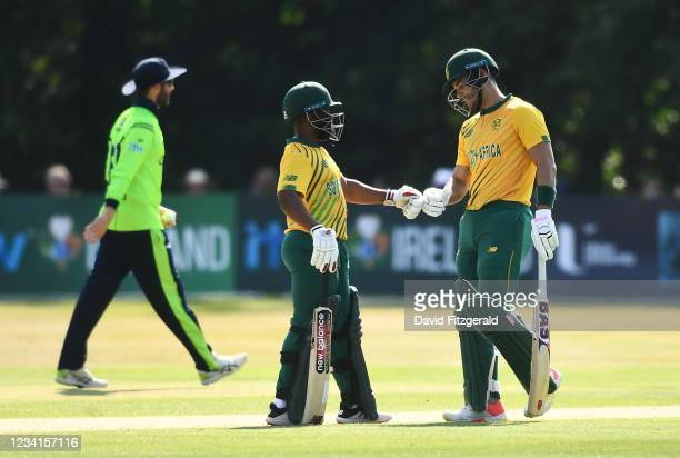 Belfast , United Kingdom - 24 July 2021; Temba Bavuma, left, and Reeza Hendricks of South Africa fist bump during the Men's T20 International match...