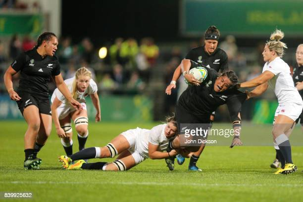 Belfast United Kingdom 26 August 2017 Aldora Itunu of New Zealand is tackled by Abbie Scott of England during the 2017 Women's Rugby World Cup Final...