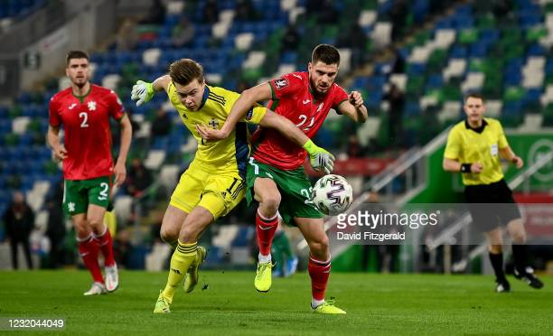 Belfast , United Kingdom - 31 March 2021; Andrea Hristov of Bulgaria tussles with Northern Ireland goalkeeper Bailey Peacock-Farrell during the FIFA...