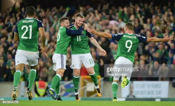 Belfast United Kingdom 4 September 2017 Chris Brunt centre of Northern Ireland celebrates with Oliver Norwood left and Conor Washington after scoring...