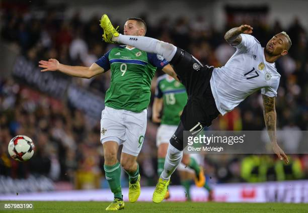 Belfast United Kingdom 5 October 2017 Conor Washington of Northern Ireland in action against Jérôme Boateng of Germany during the FIFA World Cup...