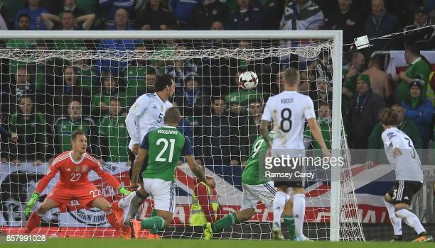 Belfast United Kingdom 5 October 2017 Josh Magennis of Northern Ireland scores his side's first goal of the game during the FIFA World Cup Qualifier...