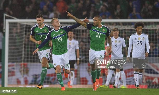 Belfast United Kingdom 5 October 2017 Josh Magennis of Northern Ireland celebrates with George Saville after scoring his side's first goal of the...