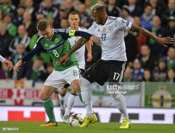 Belfast United Kingdom 5 October 2017 Steven Davis of Northern Ireland in action against Jérôme Boateng of Germany during the FIFA World Cup...