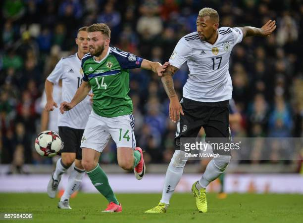 Belfast United Kingdom 5 October 2017 Stuart Dallas of Northern Ireland in action against Jérôme Boateng of Germany during the FIFA World Cup...