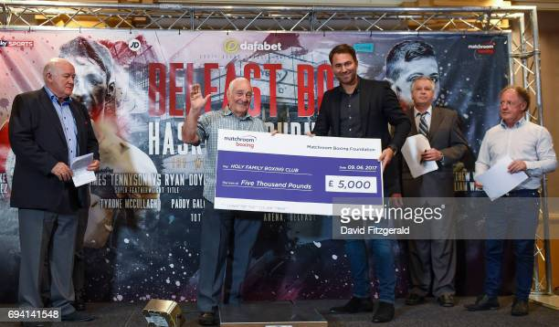 Belfast United Kingdom 9 June 2017 Matchroom Boxing promoter Eddie Hearn presents a cheque to Gerry Storey of the Holy Family Boxing Club during the...