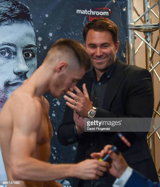 Belfast United Kingdom 9 June 2017 Matchroom Boxing promoter Eddie Hearn watches on as Ryan Burnett is interviewed following the weigh in ahead of...