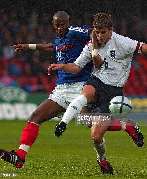 Abdoulaye Balde of France gets tangled up with Martin Cranie of England 29 July 2005 during the first half of the under19 European Championships at...