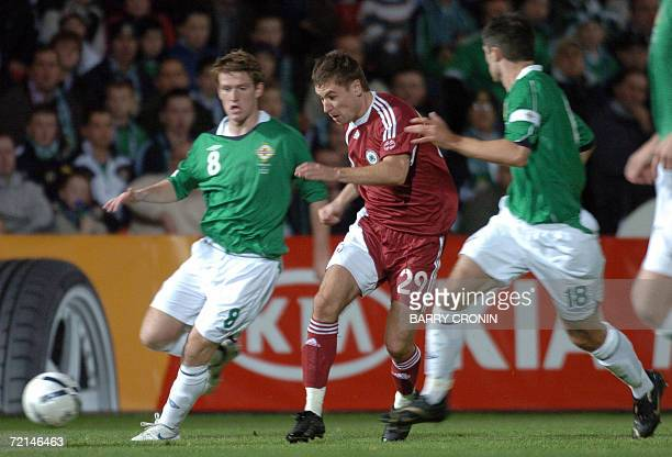 Latvia's Marians Pahars vies with Northern Ireland's players during the Euro 2008 qualifying Group F football match Northern Ireland vs Latvia 11...