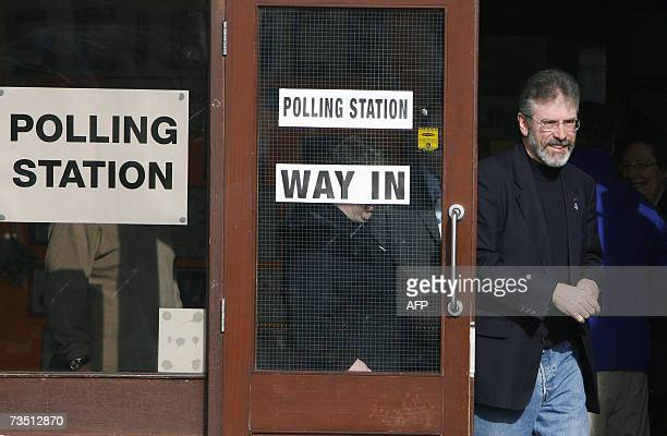Belfast, UNITED KINGDOM: President of Sinn Fein, Gerry Adams emerges from a polling station in West Belfast 07 March 2007 after casting his vote....