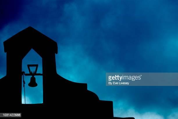 belfry on a moody sky background - 僧院 ストックフォトと画像