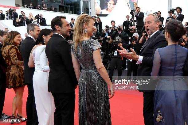 Belgian actor Benoit Poelvoorde gestures as he arrives with French actress Marina Fois French actor Guillaume Canet French actress Leila Bekhti...