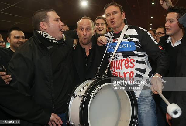 Belgian actor Benoit Poelvoorde poses with Charleroi football club's supporters prior to the premiere of 'Les Rayures du Zebre' a film directed by...