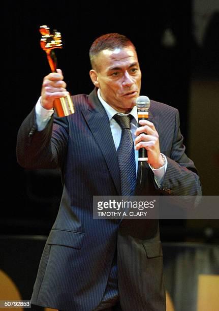 Belgian actor Jean Claude Van Damme holds his Honorary Award during the 2004 Bollywood Movie Awards at the Trump Taj Mahal 01 May 2004 in Atlantic...
