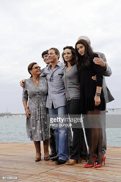 Belgian actor JeanClaude Van Damme poses with his family his mother Eliana Van Varenberg son Kristopher wife Gladys Portugues father Eugene Van...