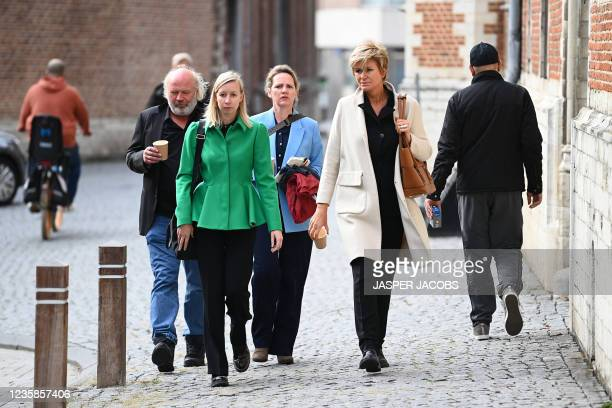 Belgian actress Maaike Cafmeyer and her partner Frans Grapperhaus accompanied by her lawyer, An-Sofie Raes and Christine Mussche arrive before the...