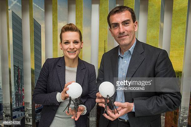 Belgian actress Veerle Baetens and KBHB-ARHB chairman Marc Coudron pose with their during the ceremony for the 'Award for Political Courage 2013' on...
