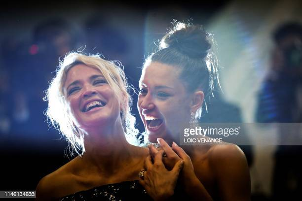 TOPSHOT Belgian actress Virginie Efira and French actress Adele Exarchopoulos laugh as they leave the Festival Palace after the screening of the film...