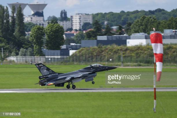Belgian Air Force F16 AM fighting jet a military war aircraft on an aerobatic air show display during the 53rd Paris Air Show in Le Bourget Airport...
