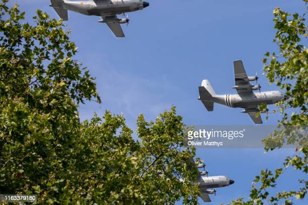Belgian Airforce C130 Hercules plane with Invasion Stripes participates in the Military Parade during the National Day of Belgium 2019 on July 21...