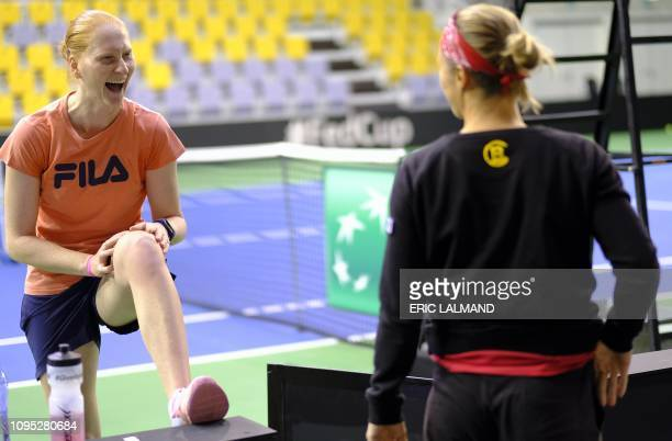 Belgian Alison Van Uytvanck and Belgian Kirsten Flipkens pictured during a training session ahead of the quarterfinal of the Fed Cup meeting between...