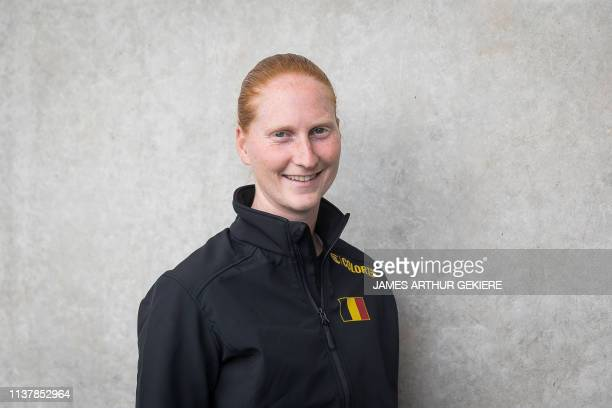 Belgian Alison Van Uytvanck poses for the photographer at a press conference regarding the Fed Cup World Group playoffs tennis between Belgium and...
