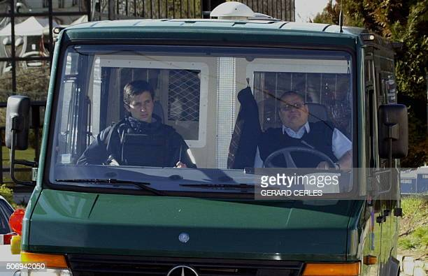 Belgian alleged paedophile Marc Dutroux leaves in an armoured police car at the Arlon's assize court 19 april 2004 on the 27th day of his trial The...