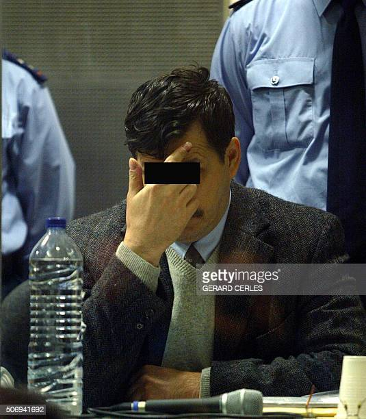 Belgian alleged pedophile Marc Dutroux is seen in the defendant's box in the Arlon courthouse 02 March 2004 in southeastern Belgium The trial of...