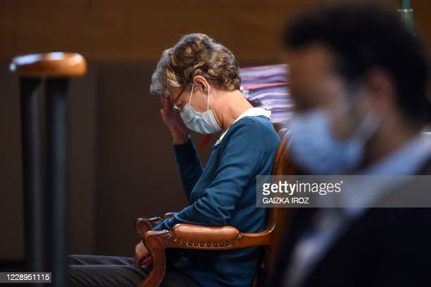 Belgian anaesthetist Helga Wauters sits in the courtroom in Pau on October 8, 2020 moments before the start of her trial for manslaughter, accused of...