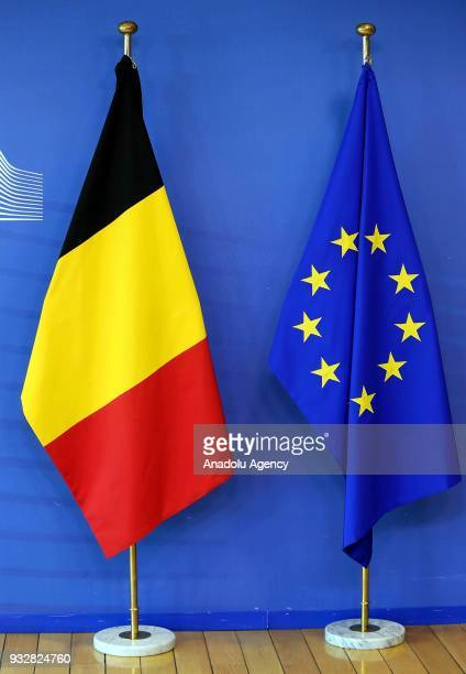 Belgian and European Union flags are seen at the VIP entrance of European Commission Headquarters in Brussels, Belgium on March 16, 2018.