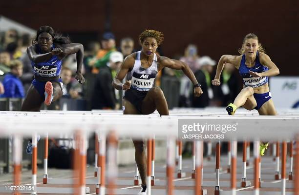 Belgian Anne Zagre pictured during US Sharika Nelvis and Bulgaria's Elvira Herman pictured in action during the women's 100m hurdles race at the 2019...