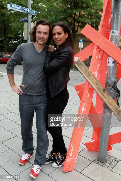 Belgian artist Arne Quinze and his wife Barbara Becker pose on a street next to an installation on September 9 2010 in Munich Germany Quinze's show...