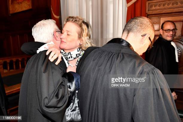 Belgian artist Delphine Boel who claims King Albert II of Belgium is her biological father embraces her lawyer after a hearing at the Cassation Court...