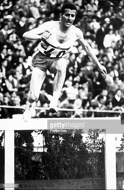 Olympic Games Tokyo Japan 3000 Metres Steeplechase Belgium's Gaston Roelants in action to win the gold medal in Olympic record time