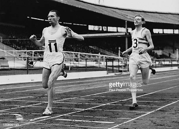 Belgian athlete Roger Moens beats Britain's Brian Hewson to first place in the 800 metres, during the British Games at White City Stadium, London,...