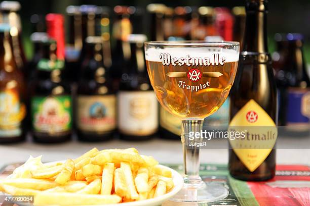belgian beer westmalle trappist tripel and belgian fries - belgian culture stock pictures, royalty-free photos & images