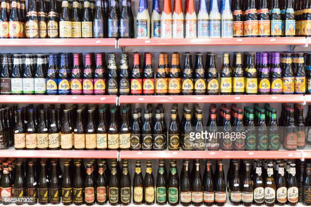 Belgian beers including famous Leffe lager and beer on shelves for sale in shop in Bruges Brugge Belgium