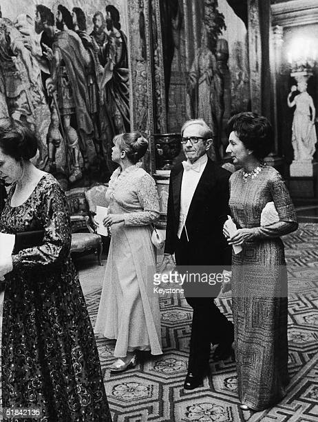 Belgian biologist and Nobel Laureate Albert Claude arrives with at the Nobel Prize Banquet, Stockholm with his wife and daughter, 11th December 1974....