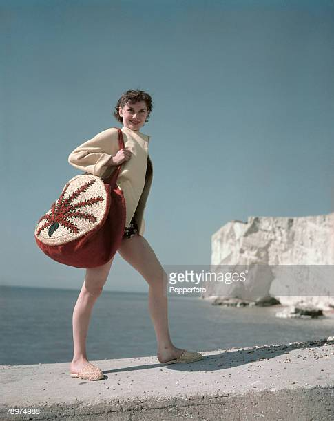 Belgian born British actress and dancer Audrey Hepburn posed with shoulder bag and espadrilles standing on the chalk cliffs by the English Channel...