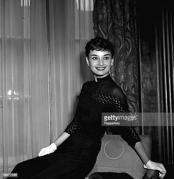 Belgian born US actress Audrey Hepburn smiling at a welcome home party for her at Claridges Hotel in London, 1953