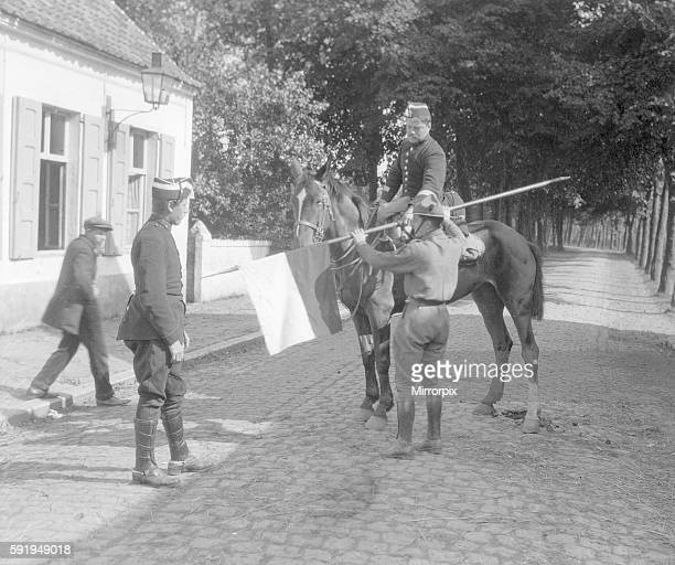Belgian boy scout with a lance he captured from a German Uhlan soldier he had shot, shows his prize to two Belgian soldiers. Scouts in the Antwerp...