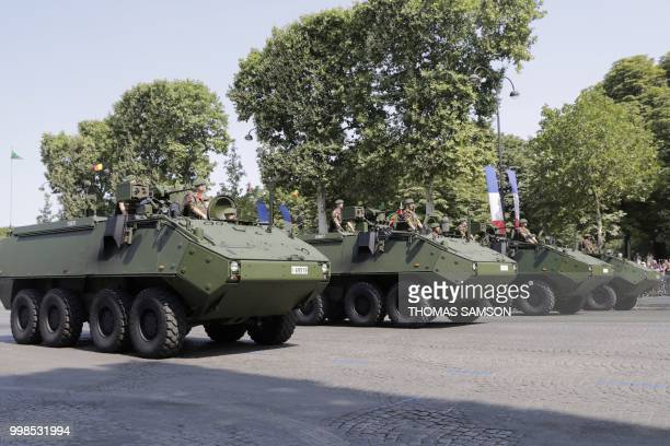 Belgian brigade mediane army officers ride on Piranha armored vehicles during the annual Bastille Day military parade on the ChampsElysees avenue in...