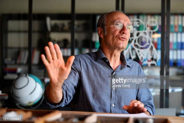 Belgian cartoonist Philippe Geluck, creator of the comic strip Le Chat , gestures during an interview with AFP about 'the world after' the...