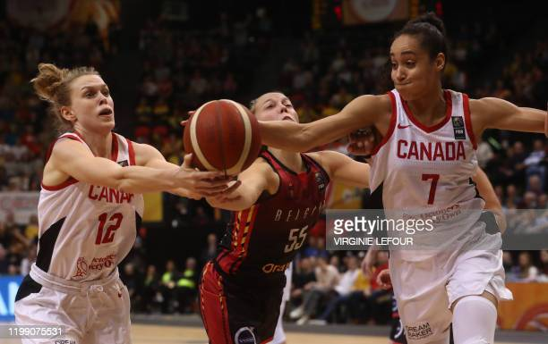 Belgian Cats Julie Allemand and Canada's Nayo RaincockEkunwe fight for the ball during a basketball match between Belgium's national team The Belgian...