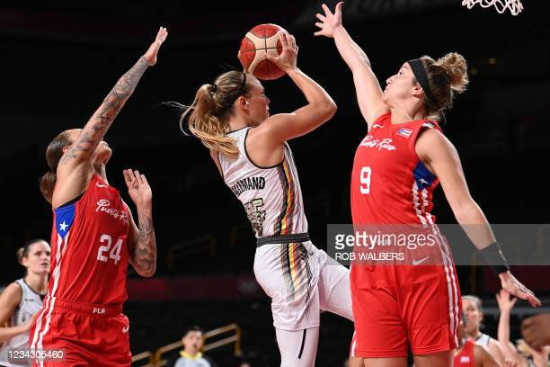 Belgian Cats Julie Allemand and Puerto Rico's Ali Gibson fight for the ball during a basketball game between Belgium's Belgian Cats and Puerto Rico,...
