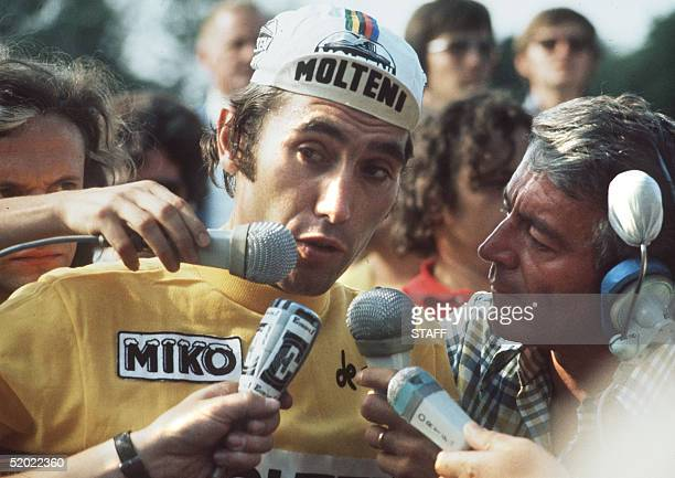 Belgian champion Eddy Merckx answers journalists upon the final stage of Tour de France 21 July 1974 at the velodrome municipal in Vincennes after...