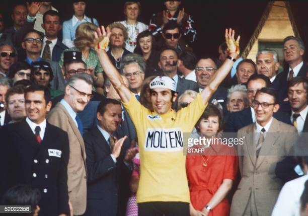 Belgian champion Eddy Merckx rises his arms as victory sign 21 July 1974 at the velodrome municipal in Vincennes after winning the Tour de France for...