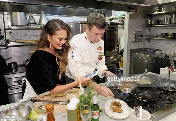 Belgian Chef Bart Vandaele leads a traditional Belgian cooking demonstration with Chrissy Teigen as part of the 'King's Feast' to celebrate a season...